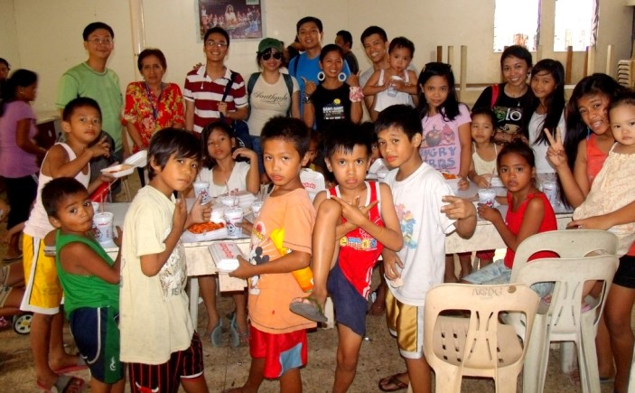 Catholic Charities Manila feeds schoolchildren in a feeding program funded by contributions from Catholic communities